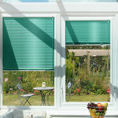 What a superb way to add the wow to your conservatory. This gloss finished turquoise venetian blind will make a brilliantly colourful statement and will coordinate fantastically with other shots of bright hot colour.