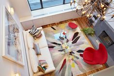 15 Living Room Layouts From Above // The bright rug, chair, and pillows are…