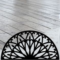 This decorative Wrought Iron Wall Art piece, Style 196,  features a Geometric half circle silhouette perfect for displaying over a door, window or mantle. It is coated in one of the most long-lasting finishes available - a flat black baked-on powder coated finish that will last for many years. Wrought Iron Wall Art, Mantle, Half Circle, Tile Floor, Art Pieces, Wall Decor, Display, Powder, Silhouette