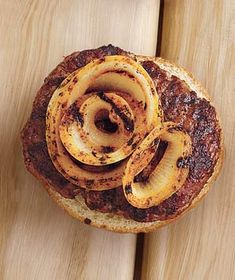Cajun Grilled Onions  Ingredients  1 large onion, sliced into 1/2-inch-thick rounds  1 tablespoon olive oil  2 teaspoons Cajun or blackening spice mix  Directions  Heat grill to medium-high. Brush both sides of the onion rounds with the olive oil and sprinkle with the Cajun mix. Grill until blackened and tender, 5 to 6 minutes per side.