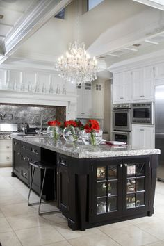 Gorgeous #kitchen with beautiful chandelier and crown moldings. http://www.remodelworks.com/