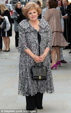 Coronation Street star Barbara Knox. I like her basic black underneath with an attention-grabbing overcoat.