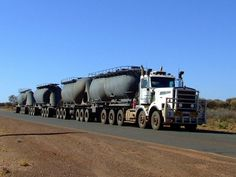 Twin Steer KW TriDrive pulling 4 TriAxle cement OR bulk style bottom drop trailers, with 3 axle dollies, Australian road trains are amazing to say the least. Rv Truck, Train Truck, Road Train, Big Rig Trucks, New Trucks, Heavy Duty Trucks, Heavy Truck, Diesel Cars, Diesel Trucks
