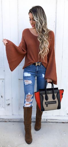 #fall #outfits women's brown scoop-neck long flare sleeve shirt with blue distressed denim jeans and brown leather knee-high boots