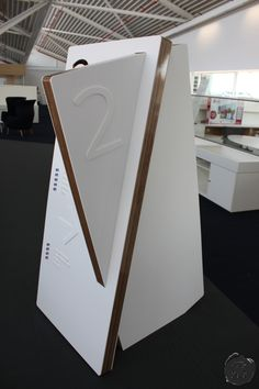 spacemanstudio.co.uk design, fabricate and install this close up of the finish of sky's totems, using marine ply birch wood with a high gloss finish and matt white acrylic front and back.
