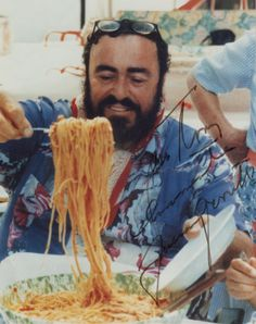this is the late great Luciano Pavarotti rare photo because you usually see him in a tux singing. Look at the enjoyment he is ready to eat ! Luciano signed this to me in Italian and I would like to thank my good friend Gina Ceresi who studied Opera in Italy with Pavarotti and they worked together at the Met in NYC.