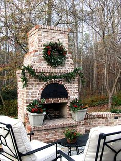 outdoor fireplace decorated for christmas