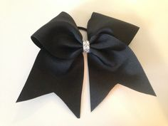 How to make a cheer bow!  I like how she puts the pony band under the zip strip before tightening it.