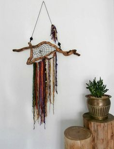 Check out this item in my Etsy shop https://www.etsy.com/uk/listing/265223353/wooden-dream-catcher-unusual-bohemian