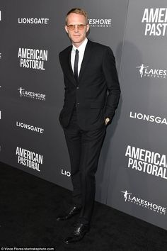 Lean: Jennifer's husband Paul Bettany, 45, also looked dashing in a fairly straightforward outfit consisting of a simple black suit, white button down shirt, black oxfords and some nifty orange-hued glasses