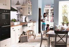 IKEA KITCHEN Alt. White cabinets, black appliances, magazine ad layout (icy blue walls adjacent)