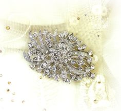 Wedding brooch Rhinestone firework style brooch adornment, Sash Applique, Buckle, Hair comb, Clutch Bridal Jewelry. $15.00, via Etsy.