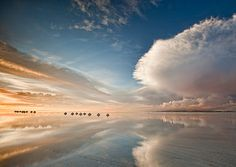 Salar de Uyuni, Bolivia During the rainy season, the world's largest salt flat becomes the world's largest mirror. The Salar was born when several prehistoric lakes joined into one. The salt flat is so reflective, it's used to calibrate satellites.