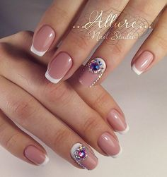 French Tip Decorated with Rhinestones. Bored with the regular French tip? Here's what you can go with.