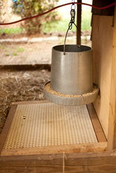 A smart way to keep chickens from wasting food......a grid to catch spilled grains