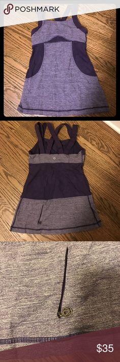 Lululemon cross cross back top with built in bra Two tone purple top with built in bra, cross cross and straight straps, super supportive lululemon athletica Tops Tank Tops