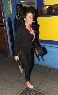 Amy Winehouse Photos Photos - British crooner Amy Winehouse enjoys a night out in the Camden district of London. The soul queen started her evening at the Hawley Arms pub before going on to the Proud Gallery leaving there at 3am. - Amy Winehouse in Camden
