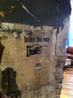 Toilet sign - on walls.