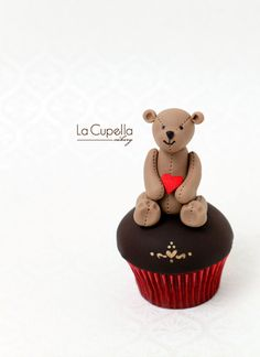 A red velvet cupcake topped with a Valentine Teddy..