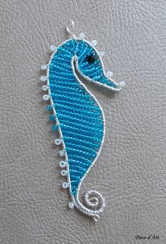 Seahorse Pendant of silver plated non tarnish wire, Toho beads, seed beads and black glass crystal. Dimensions: 8 cm