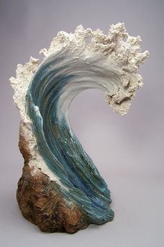 Denise Romecki Ceramic Sculpture. Great expressive feature of water and also shown through texture of water aspect in sculpture. Great use of colour but which is not overpowering and also simple in design.