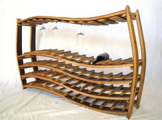 """Items similar to Wave Large Wine Barrel Rack w/glass holders made from reclaimed Napa wine barrels - recycled! WINE RACK - """"Ornellaia"""" on Etsy Barrel Projects, Diy Projects, Chianti Wine, Barris, Wine Barrel Furniture, Glass Holders, Bottle Holders, Tasting Room, Rustic Elegance"""