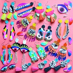 I have a serious obsession with color! Here's a few of my colorful hand painted leather earrings.