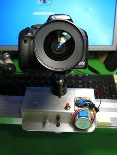 Check out http://arduinohq.com  Arduino+Stepper Motor Camera Slider