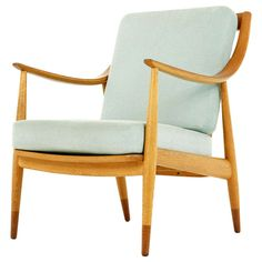 Danish Mid Century Modern Oak & Teak Lounge Chair by Peter Hvidt  | From a unique collection of antique and modern armchairs at http://www.1stdibs.com/furniture/seating/armchairs/