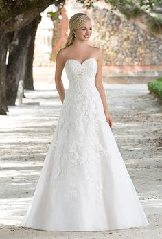 Brides: Sincerity Bridal. A traditional organza A-line gown with a sweetheart neckline and floating lace designs.