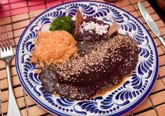 Mole is definitely a superb Mexican food, looks delicious on this blue and white Mexican ceramic plate!