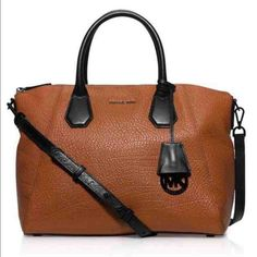 """Limited edition Authentic Mk with dust bag MICHAEL KORS CAMPBELL WALNUT BROWN PEBBLED LEATHER LARGE SATCHEL HANDBAG. Features: Walnut brown leather, black leather trim Double handles, 5"""" handle drop Detachable adjustable crossbody strap, 18"""" to 20"""" strap drop Zip closure; lined Exterior slip pocket, three interior slip pockets, interior zip pocket, interior cell phone pocket, key fob Approximate Measurements: 15""""W x 10.5""""H x 6.5""""D. It was a gift, but not my style. Make an offer MICHAEL…"""
