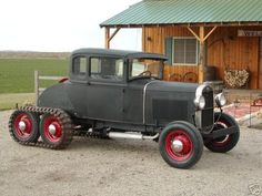 Ford Model A with snow tracks!  Bring extra blankets for the rumble seat.