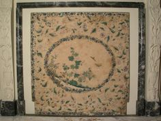 Chimney-board in the Yellow Taffeta Bedroom at Osterley Park, decorated with a Chinese picture of birds, insects, flowers and rocks surrounded by decorative floral patterns, second half 18th century, possibly originally used as wall decoration. ©National Trust Collections