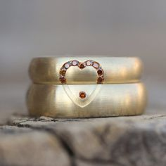 A wedding band set with heart.