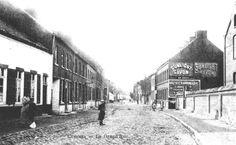 Deux pub Sunlight Savon et ?? à Cuesmes : entrée de la Grand-Rue en 1905.