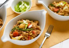 """Get more vegetable into your day with our stir-fried cauliflower """"rice"""" bowl, which is also friendly for the carb-conscious crowd.You can enjoy all the flavors of fried rice–egg, carrots and peas–on a bed of savory cauliflower """"rice."""" If you crave a protein boost,serve with a side of lean chicken or broiled shrimp."""