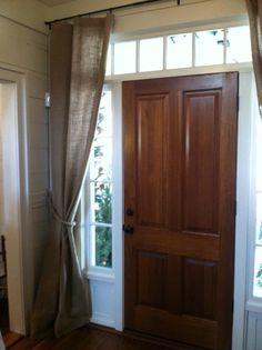 Block drafts and highlight the entry with a curtain on the inside of the front door.