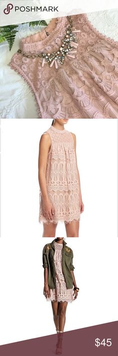 JUST IN - Romantic Lace Swing Dress This dress by Skylar & Jade is a gorgeous all over lace design in blush pink.  A great date night piece or you can add a bit of edge to it by wearing it with an army green utility jacket or black Moto jacket.  The skirt is lined by a poly/spandex blend that matches the hue of the lace.  The dress has a standup collar that mimics a turtleneck.  The back closure is special with antique brass finished buttons and elastic loops.  The dress is an A-line…