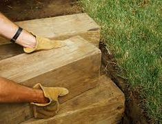 How to Build Garden Steps for a Stunning Landscape Display These wooden steps prevent erosion and ma Luxury Landscaping, Outdoor Landscaping, Backyard Landscaping, Landscaping Company, Flagstone Path, Paver Walkway, Walkway Ideas, Walkways, Yard Ideas