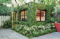 """Ivy-encased art studio in San Francisco; Scott Lewis Landscape Architecture; replaced a storage shed with this """"green cube"""" with ivy growing on a metal framework surrounding the studio. Parkside Garden - SLLA Once you click on this image, click again for an even more detailed explanation of this award-winning design."""