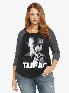 Say a little prayer for fashion wearing this black and charcoal grey raglan tee that features a print of Tupac with his name written in white.