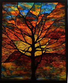 Stained Glass Sunset Tree Window with Sculpted Solder - Using our sculpted soldering technique, we build the tree up to be three dimensional, creating bark texture, weaving branches in and out, doing our best to capture a bare winter tree. The spectacular glass allowed us to capture that sparkle that a late sunset can create, and helped bring this project together. See more @ WWW.waynecain.com