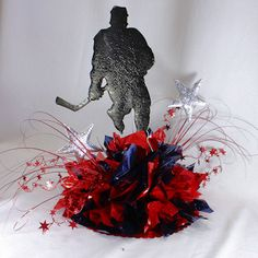 """Hockey themed centerpiece idea. Hard to find Hockey player Cut out. made of durable 3/16"""" thick foam board. Choose from 18 cracked ice colors to decorate in your team colors. www.awesomeevent.com"""