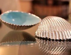 Spray paint the inside of your seashell a high-gloss coastal color and the outside a metallic...beautiful!