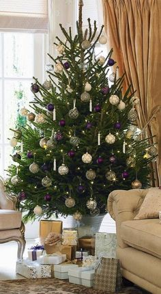 Overload your tree with ornate decorations but keep the colour scheme simple with gold and silver baubles and a hint of purple. Photography: Oliver Gordon. housebeautiful.co.uk