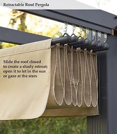 Retractable Roof Pergola. ~ This would also work for a shade curtain for the fire pit. This would be retractable and easily replaced. Run a bar from tree to tree and then use curtain clips to attach whatever fabric we want. Draw it back and forth accordingly.