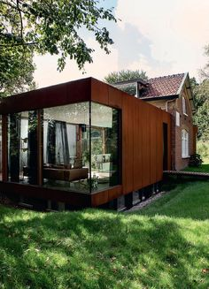 corten Steel structure added to vintage brick home/ClippedOnIssuu from Elle decoration uk 2014 04