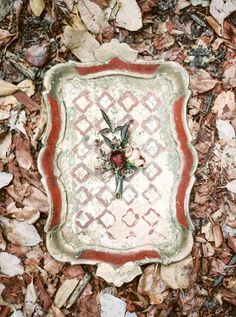 Red and Gold Vintage Tray with a Boutonniere for the Groom | Taralynn Lawton Photography | https://heyweddinglady.com/moody-dark-fairy-tale-wedding-shoot-mountains/