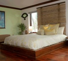 bamboo headboard diy with bamboo roll shade and frame mounted to wall